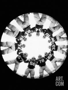 Football Huddle Photographic Print by H. Armstrong Roberts at Art.com