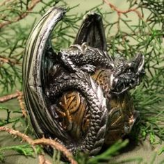 dragons protecting baubles like their own eggs is what your christmas tree needs this year holidays pinterest dragons christmas tree and clay