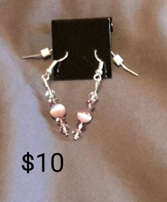 Light lavender cats eye & light purple Swarovski crystal silver earrings.