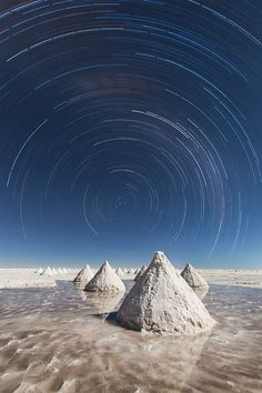 Star trail, Salar de Uyuni, Bolivia. Salar de Uyuni, amid the Andes in southwest Bolivia, is the world's largest salt flat. It's the legacy of a prehistoric lake that went dry, leaving behind a desertlike, 11,000-sq.-km. landscape of bright-white salt, rock formations and cacti-studded islands. Its otherworldly expanse can be observed from central Incahuasi Island. Though wildlife is rare in this unique ecosystem, it does harbor many pink flamingos.