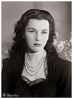 Princess Fawzia of Egypt, Empress of Iran. She is wearing her famous three strand necklace of perfectly matched natural salt water pearls.