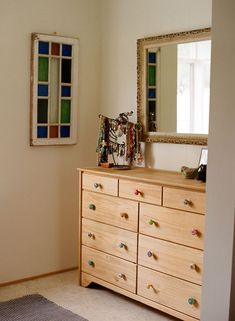 I love the variety of drawer pulls and the old stained glass. Nice colors!