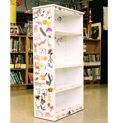 An unfinished wooden bookshelf was painted white. The top, sides, and front of each shelf were decorated with pictures of animals drawn by the children. The animals were cut out and glued to the bookshelf with several coats of sealant. The shelf was created by a 1st grade class and sold for $500.