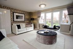 Chill down in this cosy living room in Riverside Gardens.