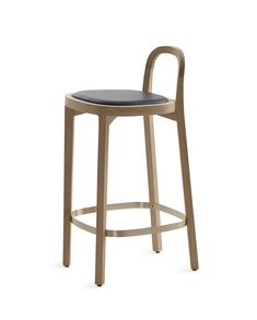 Woodnotes Siro+ bar stool, oak and finished with a polished 65cm, black leather upholstered seat.  The Siro+ barstool was one of the 2018 winners in the German Design Award's Excellent Product Design category. The honour is handed out by the German Design Council, a leading competence centre for design promotion.