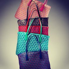 The Liberty London tote bag - stacked up high in its variety of colours.  Shop the collection: http://www.liberty.co.uk/fcp/categorylist/dept/liberty-of-london_accessories