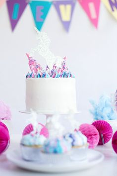 White background with pops of color from this Vibrant Unicorn Party at Kara's Party Ideas. But don't miss...