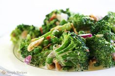 Broccoli Salad 1 teaspoon salt 5-6 cups fresh broccoli florets (about 1 pound of florets) 1/2 cup toasted slivered almonds 1/2 cup cooked, crumbled bacon 1/4 cup of red onion, chopped 1 cup of frozen peas, thawed (or fresh peas if you can get them) 1 cup mayonnaise 2 tablespoons apple cider vinegar 1/4 cup honey