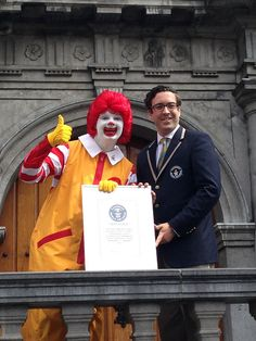 Ronald McDonald accepting Guinness Book of World Record from Guinness World Records Judge Jack Brockbank at the International Redhead Festival in Breda, The Netherlands, Sept. 1, 2013