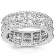 Surprise her with this exquisite diamond eternity band which is hand crafted in 18k White Gold. The center is channel set with 64 round cut diamonds which total to 1.91 carats and pave set with 225 small round cut diamonds which total to 0.70 carats. The frame measures to 1/4 Inches in width and weighs approximately 5.4 grams. This uniquely designed womens diamond eternity band is an ideal gift for that special someone. $3,648.00