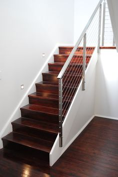 Pine stairs with dark stain and a stainless steel balustrade