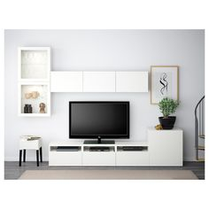IKEA BESTÅ, TV storage combination glass doors, white, Selsviken high gloss white clear glass, The drawers have integrated push openers so that you can open them with just a light push. The space saving wall cabinets make the most of the wall area above Tv Wand Besta, Besta Tv Bank, Ikea Living Room, Living Room Trends, Living Room Furniture, Living Room Decor Around Tv, Tv Storage, Storage Spaces, Record Storage