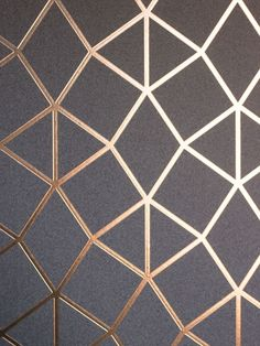 This Geo Trellis Wallpaper by Fine Decor has a triangular pattern consisting of striking metallic copper foil embedded on a granite effect textured charcoal grey background. Metallic Wallpaper, Grey Wallpaper, Painting Wallpaper, Home Wallpaper, Textured Wallpaper, Grey Pattern Wallpaper, Wallpaper Designs For Walls, Luxury Wallpaper, Grey Walls Living Room