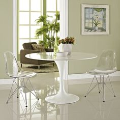 These molded plastic chairs are both flexible and comfortable, with an intricate and sturdy wire base. Suitable for indoors or out and appropriate for the living and dinning room, these versatile chairs are a great addition to any home décor statement.