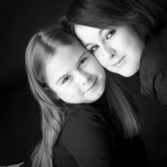 portrait photo of mother and daughter