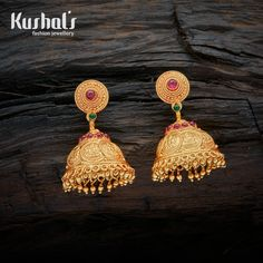 This is a traditional south Indian jhumki with coins depicting Laxmi goddess. Handcrafted in pure Silver (92.5) with Ruby Green Jhumka Earrings with Hanging Beads & spinal stones.