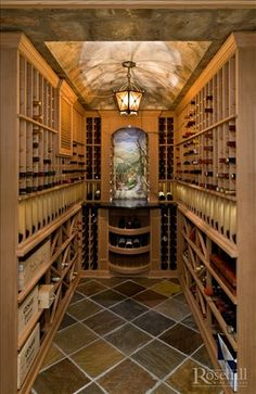 Custom #wine cellar racking with barrelled ceiling. More great #winestorage and #winerooms at Rosehill Wine Cellars.