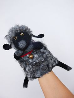 the whimsical sheep hand puppet, wet felted