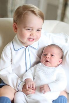 A delighted Prince George with sister Princess Charlotte.