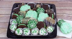 Ingallina's Box Lunch Seattle offers St Patrick's Day Deluxe Goodie Tray with an assortment of brownies, cake bites and cookies including our Shamrock Shortbread and our Mint Chocolate Chip cookies.