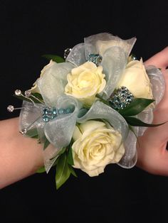 All Seasons Floral- this wrist corsage was made with a wide ribbon, giving it a unique look