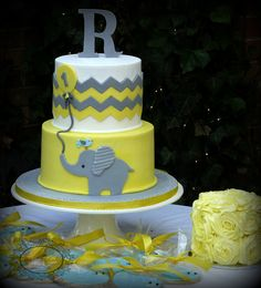 Yellow and grey chevron baby elephant 1st birthday cake with yellow rosette smash cake and blue bird custom cookies.