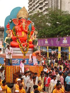 Ganesh Festival, India, Mumbai.    Artistic plaster of Paris (originally clay) models of Ganesha is worshiped for 10 days from Bhadrapada Shudha Chaturthi to the Ananta Chaturdashi, On the 11th day, the statue is taken through the streets in a procession accompanied with dancing, singing, and fanfare to be immersed in a river or the sea symbolizing a ritual see-off of the Lord in his journey towards his abode in Kailash while taking away with him the misfortunes of his devotees.