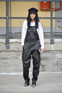 Yoyo Cao poses wearing a Diesel Black Gold overall before the Diesel Black Gold show during the Milan Fashion Week Fall/Winter 2016/17 on February 26...
