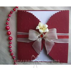 Handmade wedding invitation in red.