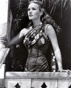 Frances Farmer movie star model photo print ad 40s sarong dress floral island hawaii fashion style 50s