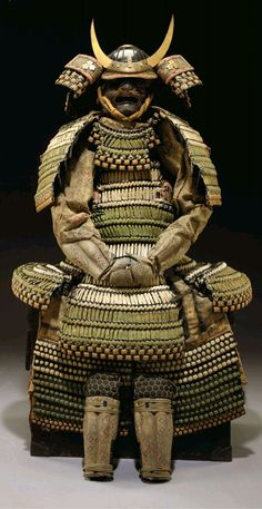 Haramaki Gusoku.Edo period (19th century)The armor comprising a twenty-eight-plate black-lacquered suji-kabuto (ridged helmet bowl) of round archaic form with a large archaic tehen-no-ana (aperture at the crown where the plates meet), surrounded by a three-tiered gilt hachimanza (decorative fixture at the tehen-no-ana), the expansive mabisashi (brim) leather-clad and with a gilt fukurin (edging), the maedate (forecrest) of two flat gilt horns in a fixture engraved with waves.