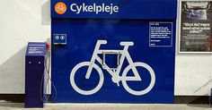 A bicycle nursing station at a gas-tank! Wow!