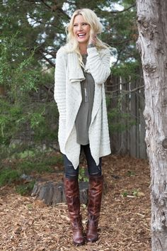 Cozy sweater, tall boots and distressed denim ... Can this get anymore fall? Shop the look in the link!