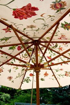 Hand painted umbrella adds whimsy to the garden.