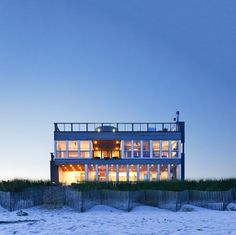 When is a box not a box? When Resolution: 4 Architecture turns a two-story prefabricated house into a spectacular coastal home on Long Island. From the stunning stainless fireplace on the 360-view deck to the cook's kitchen on the main floor - you'll never want to leave this architectural gem. Glass and wood join forces to provide clean, symmetrical lines and breathtaking views from this 4-bedroom, 2.5 bathroom beach house.