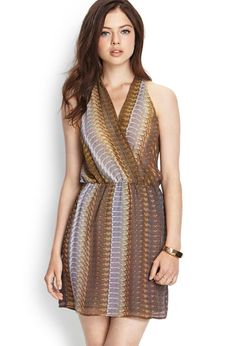 Love 21 - An abstract printed woven dress featuring a surplice front and racerback. . Elasticized ...