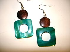 A personal favorite from my Etsy shop https://www.etsy.com/listing/103497275/mod-bluegreen-shell-earrings