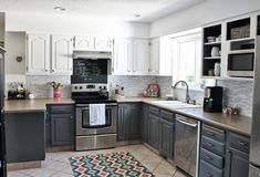 Gray and white kitchen....love the cabinet colors and the backsplash