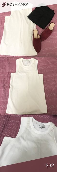 "3.1 Phillip Lim sleeveless cami top This is a 3.1 Phillip Lim sleeveless top. Great condition. Features a simple silhouette with a unique cut in the arm area. Durable material. Easy to dress up or down. NO TRADES.   Pit to pit measures approx. 15.5"" across.  I believe this is Petite sizing. 3.1 Phillip Lim Tops Camisoles"