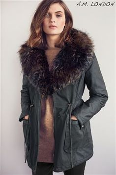 Woman wearing wet-look leggings and winter coats from Next ...