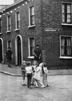 """historicaltimes: """" Children playing while ignoring an armed patrol, Belfast, Northern Ireland, 31 October 1974 """" Northern Ireland Troubles, Visit Northern Ireland, Belfast Northern Ireland, Northern Irish, County Cork Ireland, Galway Ireland, Ireland Vacation, Ireland Travel, Ireland Landscape"""
