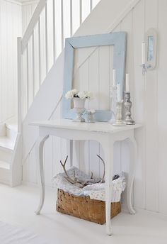 vintage  WHITE ON WHITE  table , frame and basket make a beautiful foyer