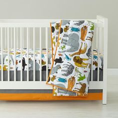 """""""Welcome to the jungle"""" (!!!) toddler bedding, designed by my amazamatroid friend, Lisa Congdon! (Available at the The Land of Nod)"""