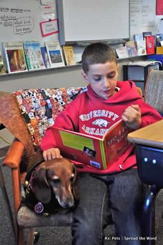 Doxie listening to child read a story. Since 2000 Rx: Pets has been bringing the healing power of pets to communities in Northern California....