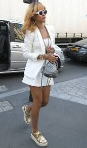 Rihanna hits Paris in all-white sports luxe style and metallic ...