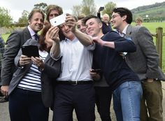 Britain's Prime Minister David Cameron joins local supporters in a 'selfie' photograph whilst campaigning in Norton Sub Hamdon near Yeovil, southwest England, Britain, April 25, 2015. REUTERS/Toby Melville