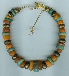 Love these colors together- Antique Moroccan Berber jewelry with real amber and old amazonite beads