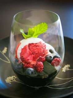 Fresh summer berries with basil seed, ginger, lime syrup & berry sorbet