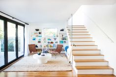 Aside from living on the sand with the ocean as your backyard, this home tour is next best thing. It's California coastal with clean modern lines and cheeky beach decor masterminded by Orlando Soria of Homepolish. What does a perfectly executed Beach Cottage Style, Coastal Style, Coastal Decor, Wood Staircase, Stairs, Staircases, Staircase Design, Home Decor Bedroom, Diy Home Decor