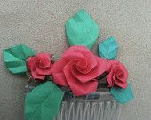 A handcrafted fascinator with a trio red origami roses and dark green leaves  www.etsy.com/listing/191805470/trio-of-red-paper-origami-roses-with?ref=shop_home_active_11 #tinycranesboutique